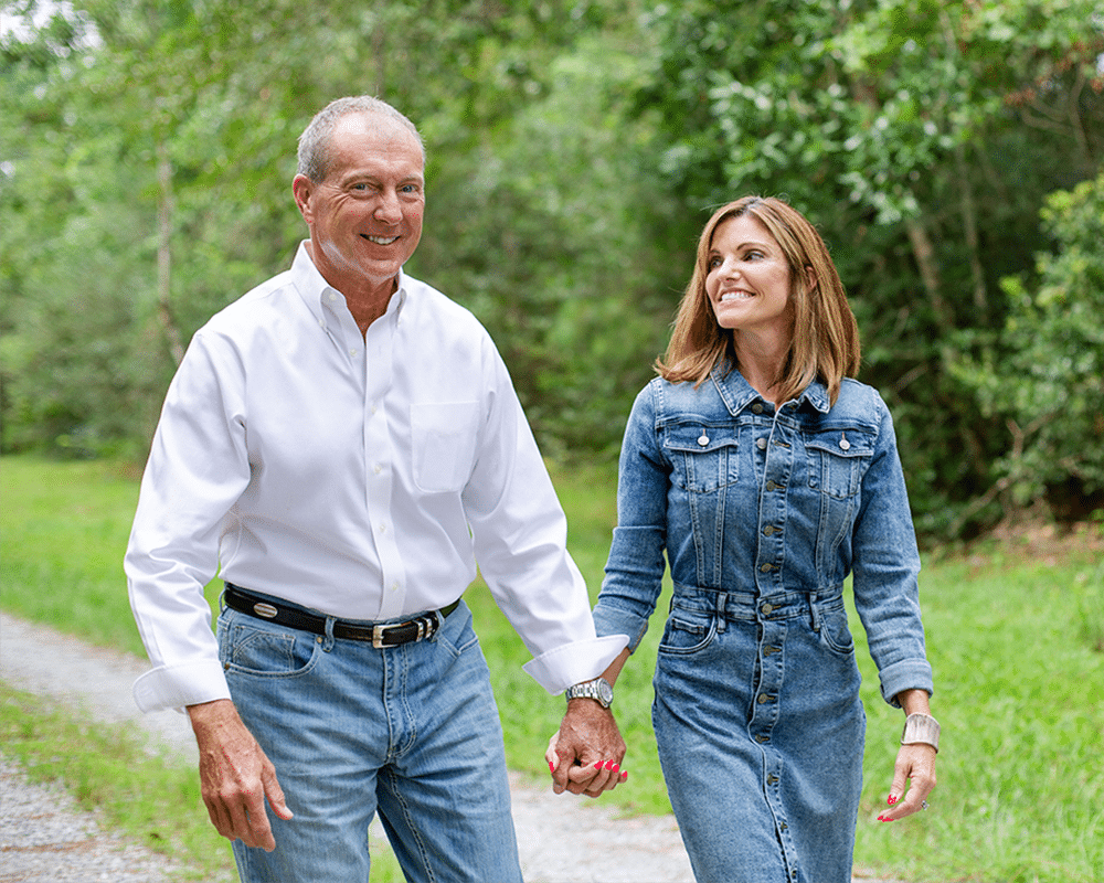 Clay Wagner for Congress walking through Mississippi holding hands with his wife.