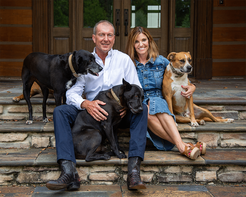 family photo of clay wagner with his wife and three dogs